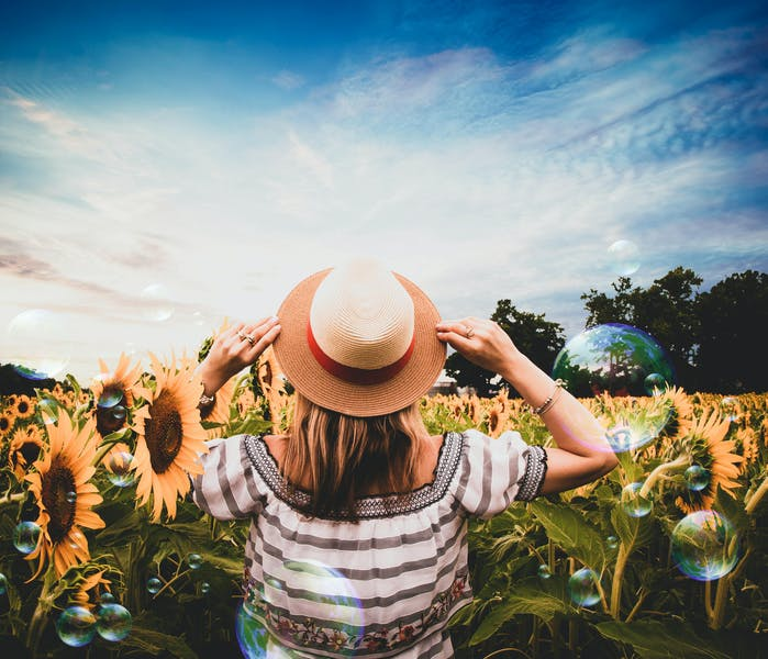 P 2 standing woman surrounded of sunflowers 1260988 pexels